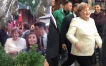 المستشارة الألمانية أنجيلا ميركل  تتجول بأحد أسواق مدينة مراكش ومحاطة بحراسة مشددة/ فيديو