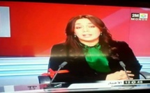 مذيعة  2ًمً  تضع شارة حمراء تعبيرا على مشاركتها في الإضراب